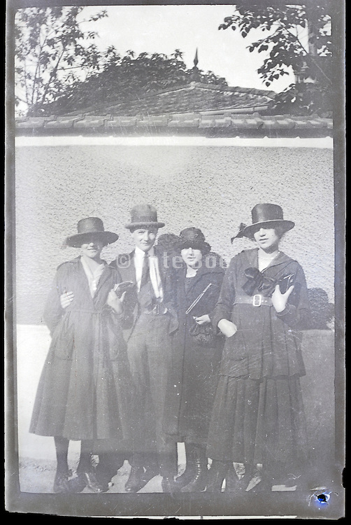 young adult male with three females 1900s