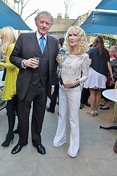 PICTURE SHOWS:-RICHARD & BASIA BRIGGS.<br /> Tuesday 14th April 2015 saw a host of London influencers and VIP faces gather together to celebrate the launch of The Ivy Chelsea Garden. Live entertainment was provided by jazz-trio The Blind Tigers, whilst guests enjoyed Moët & Chandon Champagne, alongside a series of delicious canapés created by the restaurant's Executive Chef, Sean Burbidge.<br /> The evening showcased The Ivy Chelsea Garden to two hundred VIPs and Chelsea<br /> residents, inviting guests to preview the restaurant and gardens which marry<br /> approachable sophistication and familiar luxury with an underlying feeling of glamour and theatre. The Ivy Chelsea Garden's interiors have been designed by Martin Brudnizki Design Studio, and cleverly combine vintage with luxury, resulting in a space that is both alluring and down-to-earth.
