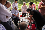 People play Dou Shou Qi or Jungle, a traditional board game at the Temple of Heaven Park in Beijing, China