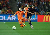 Arjen Robben<br /> Holland World Cup 2010<br /> Sergio Busquets Spain<br /> Holland V Spain 11/07/10 The World Cup Final at Soccer City<br /> FIFA World Cup 2010<br /> Photo Robin Parker Fotosports International