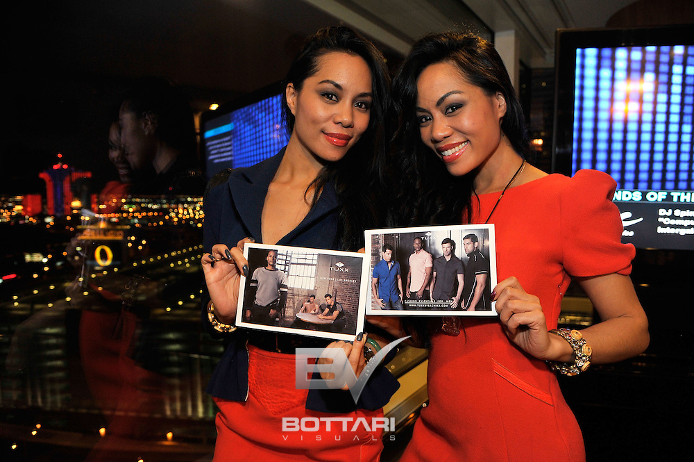 LAS VEGAS, NV - FEBRUARY 19:  (L-R) Designers To-Tam and To-Nya Sachika attend the FlauSachika Groups exclusive magic suite party at Aria Resort & Casino at CityCenter on February 19, 2013 in Las Vegas, Nevada.  (Photo by Jeff Bottari/WireImage)