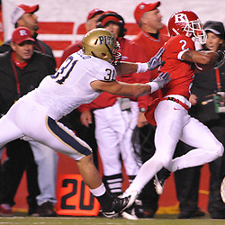Oct 16, 2009; Piscataway, NJ, USA; Pittsburgh cornerback Dom Decicco (31) pushes Rutgers wide receiver Tim Brown (2) out of bounds after Brown made a big reception during first half NCAA football action in Pittsburgh's 24-17 victory over Rutgers at Rutgers Stadium.