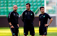 29/07/14<br /> CELTIC TRAINING<br /> PEPSI ARENA - WARSAW<br /> Celtic manager Ronny Deila (centre) is flanked by new coach Haakon Lunov and assistant John Collins (right) as his players train in Warsaw