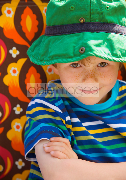 Close up of a smiling young boy wearing a hat