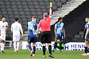 Wycombe Wanderers midfielder Dominic Gape (4) shown a yellow card, booked during the EFL Sky Bet League 1 match between Milton Keynes Dons and Wycombe Wanderers at stadium:mk, Milton Keynes, England on 1 February 2020.