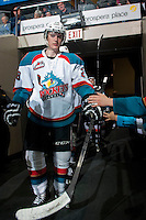 KELOWNA, CANADA - APRIL 3: Joe Gatenby #28 of the Kelowna Rockets high fives fans on his way to the ice against the Seattle Thunderbirds on April 3, 2014 during Game 1 of the second round of WHL Playoffs at Prospera Place in Kelowna, British Columbia, Canada.   (Photo by Marissa Baecker/Getty Images)  *** Local Caption *** Joe Gatenby;