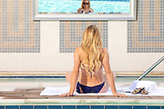 Rear View Of A Blonde Sitting By Jacuzzi