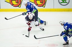 Dylan Larkin of USA between Rok Ticar of Slovenia and Blaz Gregorc of Slovenia during Ice Hockey match between Slovenia and USA at Day 10 in Group B of 2015 IIHF World Championship, on May 10, 2015 in CEZ Arena, Ostrava, Czech Republic. Photo by Vid Ponikvar / Sportida