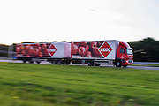 Een vrachtwagen met een extra lange trailer van C1000 rijdt over de A12 bij Utrecht.<br /> <br /> A truck with a long trailer is riding at the A12 near Utrecht.