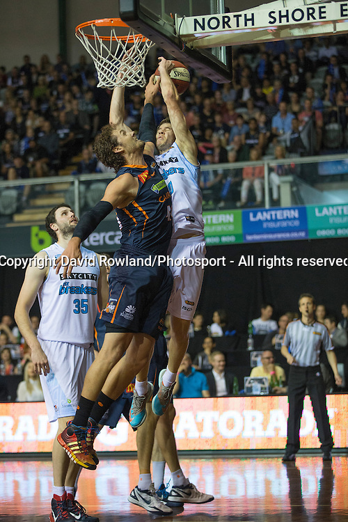 Breakers` Thomas Abercrombie and Taipans` Alex Loughton clash in the SkyCity Breakers v Cairns Taipans, 2014/15 ANBL Basketball Season, North Shore Events Centre, Auckland, New Zealand, Thursday, October 23, 2014. Photo: David Rowland/Photosport