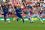 Leicester City's Danny Drinkwater and Stoke City's Jonathan Walters focus on the ball during the Barclays Premier League match between Stoke City and Leicester City at the Britannia Stadium, Stoke-on-Trent, England on 19 September 2015. Photo by Aaron Lupton.