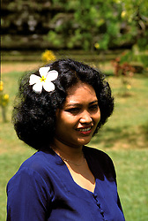 Woman, Bali, Indonesia, Asia,  photo bali216, Photo Copyright:  Lee Foster, www.fostertravel.com, 510-549-2202, lee@fostertravel.com, woman, female, smile, smiling, indonesian, native, attractive, adult, flower in hair, vertical