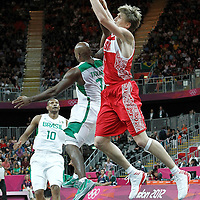 02 August 2012: Russia Andrei Kirilenko grabs the ball over Brazil Larry Taylor during 75-74 Team Russia victory over Team Brazil, during the men's basketball preliminary, at the Basketball Arena, in London, Great Britain.
