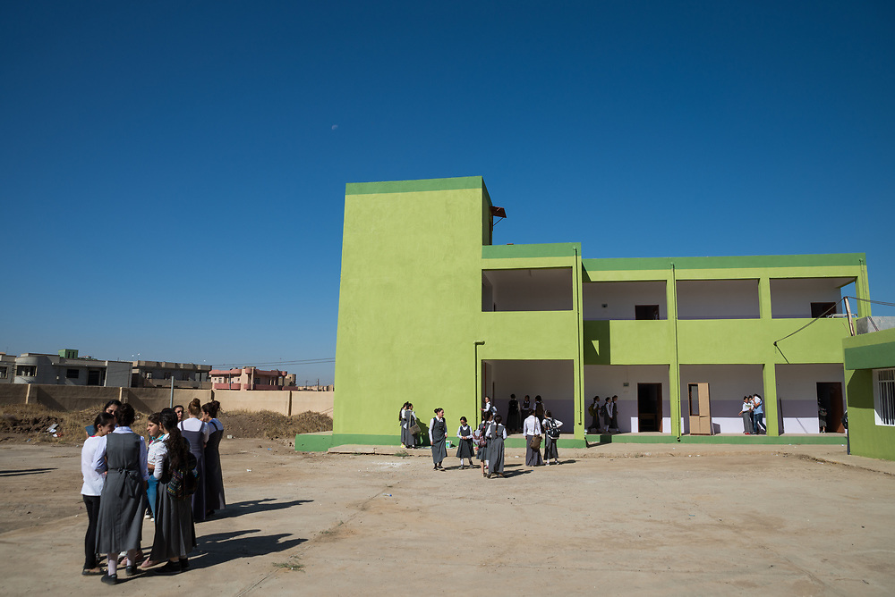 11 October 2017 &ndash; Ninewa Plains &ndash; Iraq &ndash; Pupils stand in the courtyard of the Mareem al Adhraa High School in the Hamdaniyah Sub District. <br /> <br /> UNDP&rsquo;s Funding Facility for Stabilization is helping rehabilitate the school, which re-opened on October 7, 2017. &ldquo;All of us are happy,&rdquo; said  the School's Principal Amal Azzu Petros. <br /> <br /> &copy; UNDP Iraq / Claire Thomas