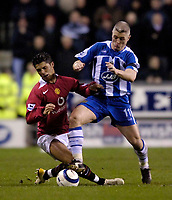 Photo: Jed Wee.<br /> Wigan Athletic v Manchester United. The Barclays Premiership. 06/03/2006.<br /> <br /> Manchester United's Cristiano Ronaldo (L) comes off second best against Wigan's Graham Kavanagh.