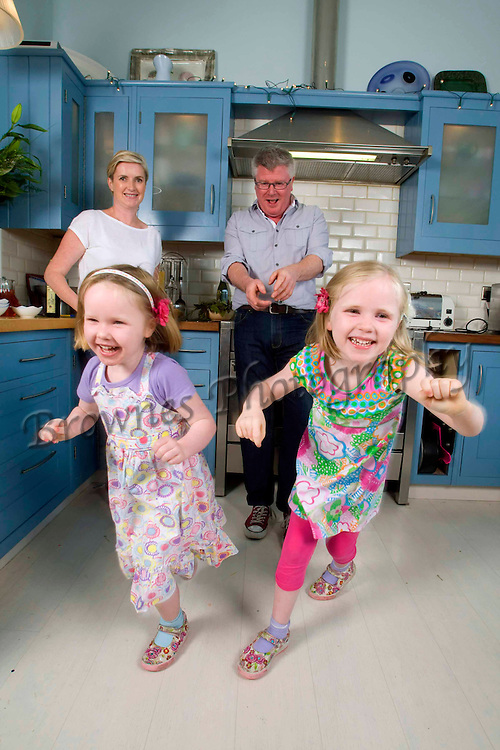 Magazine. 16/6/2011. Paul Flynn chef with his family at home at Dungarvan, Co Waterford. Pictured is Paul with daughters Anna and Ruth and wife Máire. Photo Patrick Browne