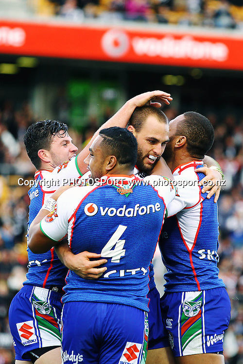 Warriors' Simon Mannering is mobbed by teamates after scoring his team's first try. Round 12 NRL Telstra Premiership game, Vodafone Warriors v Newcastle Knights, Mt Smart Stadium, Auckland, New Zealand. Sunday 1st June 2014. Photo: photosport.co.nz