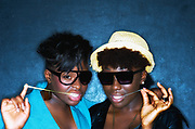 Two stylish black girls and their gum, East London,14/06/2010
