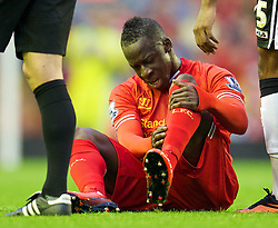 27.08.2013, Anfield, Liverpool, ENG, League Cup, FC Liverpool vs Notts County FC, 2. Runde, im Bild Liverpool's Aly Cissokho leaves the field injured just ten minutes into his full debut: the Football League Cup 2nd Round match during the English League Cup 2nd round match between Liverpool FC and Notts County FC, at Anfield, Liverpool, Great Britain on 2013/08/27. EXPA Pictures © 2013, PhotoCredit: EXPA/ Propagandaphoto/ David Rawcliffe<br /> <br /> ***** ATTENTION - OUT OF ENG, GBR, UK *****