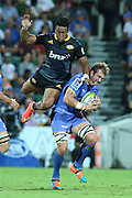 Hurricanes Ardea Savea jumps over Force's Ben McCalman in the Western Force and Hurricanes game, Super Rugby, NIB Stadium, PERTH, Western Australia. Friday, 27th February, 2015. Photo: Travis Hayto / photosport.co.nz
