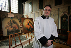 UK ENGLAND LONDON 5MAY12 - Caplain Paulo Bagini of Brasil stands in front of the De Brecy Tondo artwork, suspected to be by Reniassance painter Rafael at the Westminster Cathedral in central London...The Tondo displays striking resemblance to Rafael's Sistine Madonna, finished as a commissioned altarpiece and the last painting he completed with his own hands a few years before his death...Relocated to Dresden from 1754, the well-known painting has been particularly influential in Germany...jre/Photo by Jiri Rezac....© Jiri Rezac 2012