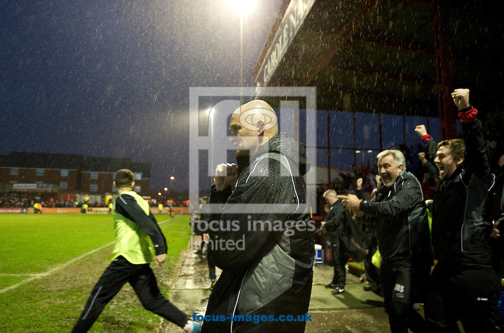 Altrincham manager Lee Sinnott (centre) clenches his fist at the final whistle following the FA Cup match at Moss Lane, Altrincham<br /> Picture by Russell Hart/Focus Images Ltd 07791 688 420<br /> 07/11/2015