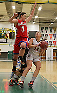 Washington's Abby Herb (3) tries to block a shot by Waukon's Daneshia Snitker (14) during the 2013 Eastern Iowa All-Star Basketball Game at Iowa City West High School in Iowa City on Wednesday, March 27, 2013. The North (white) defeated the South (dark) 68-65.