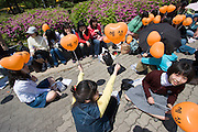 Olympic Park. Fans with balloons cueing for free tickets for a concert of pop singer Shin Hyesung.