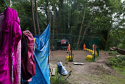 HS2 security guards monitor a compound established to facilitate tree felling in Denham Country Park on 13th July 2020 in Denham, United Kingdom. The compound is adjacent to a HS2 Rebellion wildlife protection camp created in order to try to hinder or prevent the £106bn high-speed rail project which will remain a net contributor to CO2 emissions during its projected 120-year lifetime.