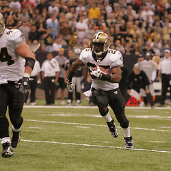 2008 October, 12: New Orleans Saints running back Reggie Bush (25) follows the block of teammate Mike Karney (44) for a three yard touchdown run against the Oakland Raiders at the Louisiana Superdome in New Orleans, LA.