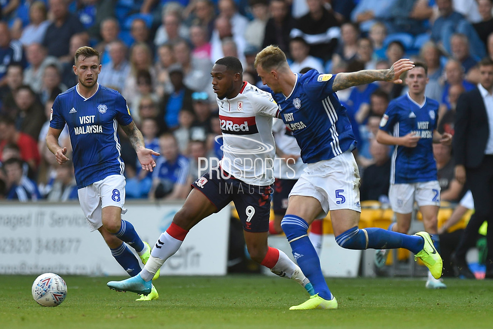 Britt Assombalonga (9) of Middlesbrough battles for possession with Aden Flint (5) of Cardiff City during the EFL Sky Bet Championship match between Cardiff City and Middlesbrough at the Cardiff City Stadium, Cardiff, Wales on 21 September 2019.