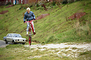 Neville riding his BMX, High Wycombe, UK, 1980s.