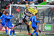 Stevenage goalkeeper Tom King (13) thwarts Notts County's Shola Ameobi(9) in an early cross during the EFL Sky Bet League 2 match between Notts County and Stevenage at Meadow Lane, Nottingham, England on 24 February 2018. Picture by Nigel Cole.