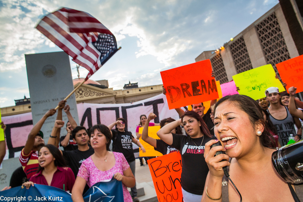 15 AUGUST 2012 - PHOENIX, AZ:  DULCE MATUZ, a DREAM Act leader in Phoenix, speaks to the crowd in front of the Arizona State Capitol. About 200 people, mostly DREAM Act  (an acronym for Development, Relief, and Education for Alien Minors) students and their family members, marched on the Arizona State Capitol in Phoenix Wednesday after Arizona Governor Jan Brewer said the state of Arizona will not give DREAM Act students any state services, including driver's licenses or tuition breaks on state universities and schools. Brewer has been a critic of President Obama's plan to defer deportations of certain undocumented young people.   PHOTO BY JACK KURTZ