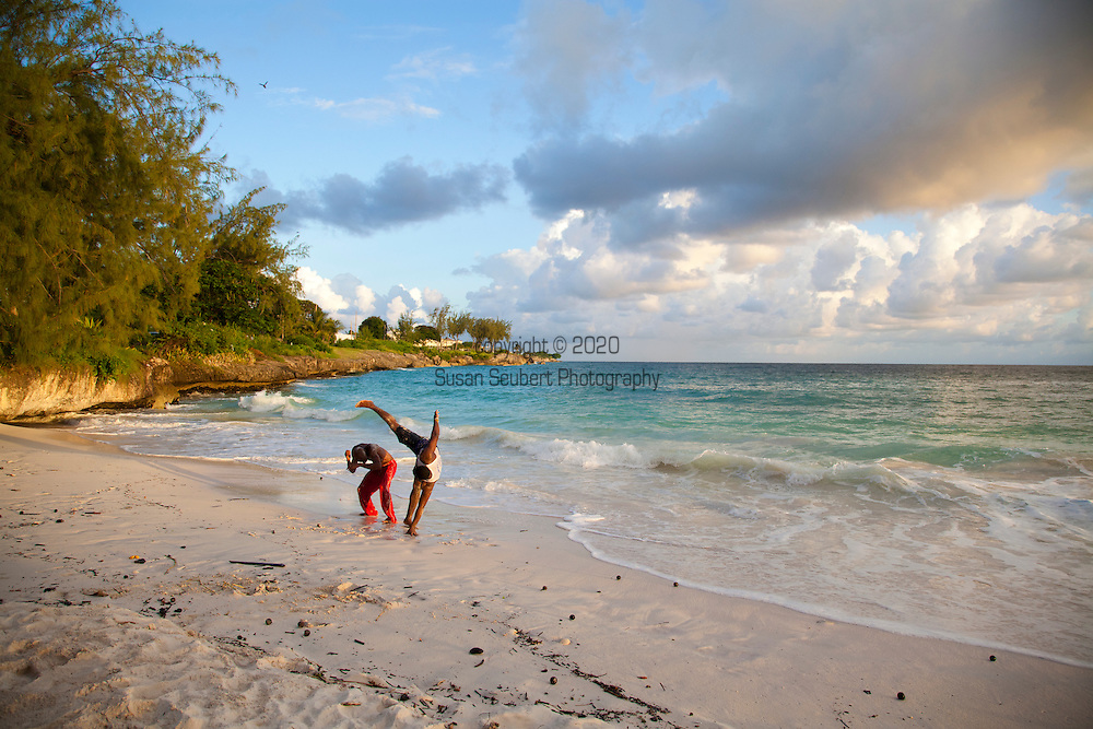 Enterprise Beach, known by the locals as Miami Beach, is located near Oistins in the parish of Christ Church and is immensely popular with the locals for early morning and late evening bathers and swimmers.  Pictured here are two men practicing martial arts.