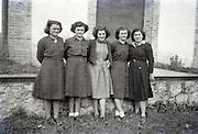 five women posing early 1960s countryside