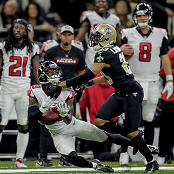 Nov 22, 2018; New Orleans, LA, USA; New Orleans Saints cornerback Marshon Lattimore (23) breaks up a pass to Atlanta Falcons wide receiver Calvin Ridley (18) during the second quarter at the Mercedes-Benz Superdome. Mandatory Credit: Derick E. Hingle-USA TODAY Sports