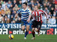 Photo: Gareth Davies.<br />Reading v Sheffield United. The Barclays Premiership. 20/01/2007.<br />Reading's Shane Long (L) out paces Sheffield United's Rob Kozluck (R).