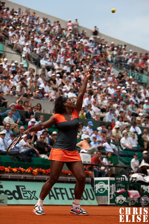 3 June 2009: Serena Williams of USA serves during the Women's single quarter final match on day eleven of the French Open at Roland Garros in Paris, France.