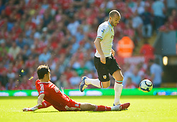 LIVERPOOL, ENGLAND - Saturday, September 12, 2009: Liverpool's Albert Riera and Burnley's Steven Fletcher during the Premiership match at Anfield. (Photo by David Rawcliffe/Propaganda)