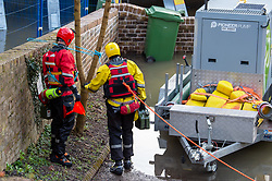 © Licensed to London News Pictures. 26/02/2020. Ironbridge, UK. Emergency personal refuel a high volume pump as flood defences are under threat of collapse in Ironbridge on part of the River Severn, police evacuated part of the town when the flood barriers moved approximately three feet under the strain of the rising water levels. Photo credit: Peter Manning/LNP