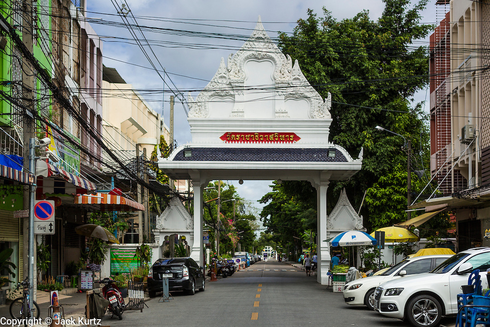 15 JULY 2014 - BANGKOK, THAILAND:  The entrance to Wat Rachathiwat Ratchaworawihan on Samsen Soi 9. The temple has a large teak instruction hall, considered one of the finest teak buildings in Asia.   PHOTO BY JACK KURTZ