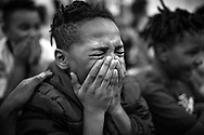 Parkview Elementary School 3rd grade student Antwon Lyntch sheds tears of joy after learning he would be getting a new bicycle to replace his broken one.<br /> <br /> Bikes For Kids Foundation, a non-profit based out of California, teamed up with six sponsors and Guilford County Schools to give away anywhere from 50 to 100 bikes at six Title 1 schools. A total of 455 bikes were given away this week. Bikes For Kids Foundation expects to continue the bike giveaway next year.<br /> When completed, a total of seven schools and 505 bicycles will be awarded.<br /> <br /> Photographed, Tuesday, December 18, 2018, in High Point, N.C. JERRY WOLFORD and SCOTT MUTHERSBAUGH / Perfecta Visuals