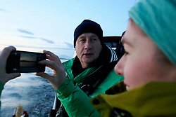 NORWAY TROMSO 5DEC15 - Greenpeace campaigners Christian Bussau and Larissa Baeumer of Germany during whale observations in Kvalsoya Sound near the arctic city of Tromso.<br /> <br /> jre/Photo by Jiri Rezac / Greenpeace<br /> <br /> © Jiri Rezac 2015