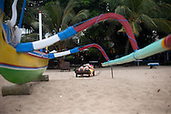 people relax at Sanur beach on the island of Bali. Sanur caters, generally, to the older European tourists, quite the opposite of Kuta which generally cators to younger travelers and party seekers.