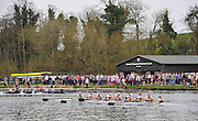 Henley. United Kingdom. Crews warming up before the regatta starts, passing Upper Thames RC. in the women's reserve boat race 2014 Henley Boat Race, Henley Reach, Annual Women's Boat Race.  River Thames; Sunday  - 30/03/2014  [Mandatory Credit;  Intersport Images],