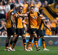 Jake Livermore of Hull City (2nd right) celebrates after scoring his team's 3rd goal to make it 3-1 during the Sky Bet Championship match at KC Stadium, Hull<br /> Picture by Russell Hart/Focus Images Ltd 07791 688 420<br /> 07/05/2016