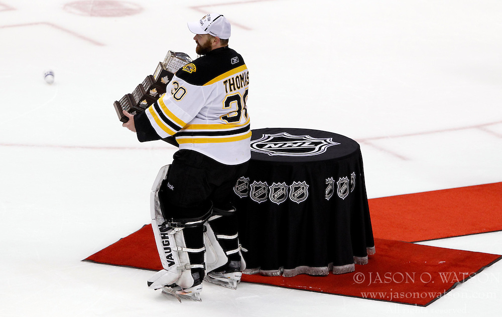June 15, 2011; Vancouver, BC, CANADA; Boston Bruins goalie Tim Thomas (30) is presented with the Conn Smythe trophy after defeating the Vancouver Canucks 4-0 in game seven of the 2011 Stanley Cup Finals at Rogers Arena. Mandatory Credit: Jason O. Watson / US PRESSWIRE