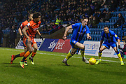 Gillingham striker Tom Eaves (9) runs with the ball tracked by Wycombe Wanderers defender Sido Jombati, Sky Bet, during the EFL Sky Bet League 1 match between Gillingham and Wycombe Wanderers at the MEMS Priestfield Stadium, Gillingham, England on 15 December 2018.
