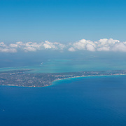 Airplane window view of Grand Cayman